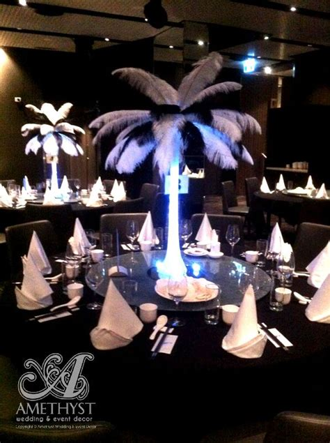 black white feather centerpieces on white eiffel vase