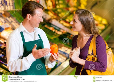 in supermarket and shop assistant stock photo