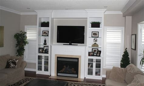 hand crafted built in wall unit for widescreen tv in custom built in wall unit traditional family room