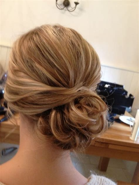 bridesmaid hair to the side messy low bun with bangs make
