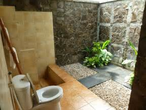 outdoor bathroom design with black timber walls and