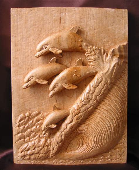 delfines talla en madera wood carving esculturas