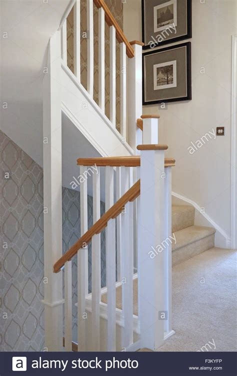 traditional timber staircase and banisters in a new three