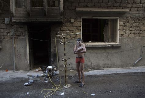 military term for bathroom a free syrian army fighter takes a shower outdoors to beat