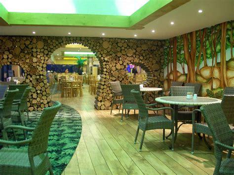 Creative cafe interior jungle theme interiordecodir com