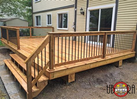 wood deck with black metal spindle railings deck