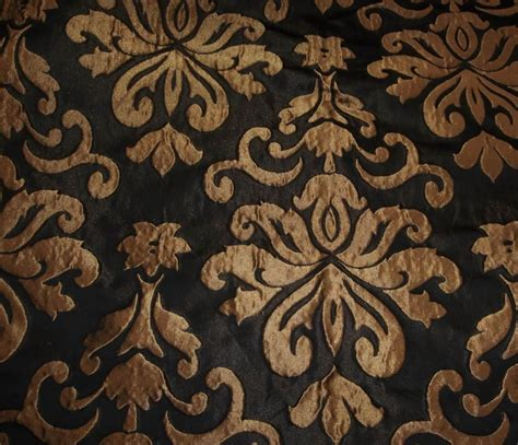 black drapery fabric gold metallic woven damask black background upholstery