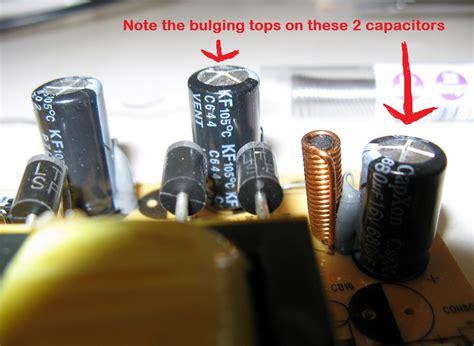 broken capacitor on motherboard do the capacitors on the picture look broken electrical engineering stack exchange
