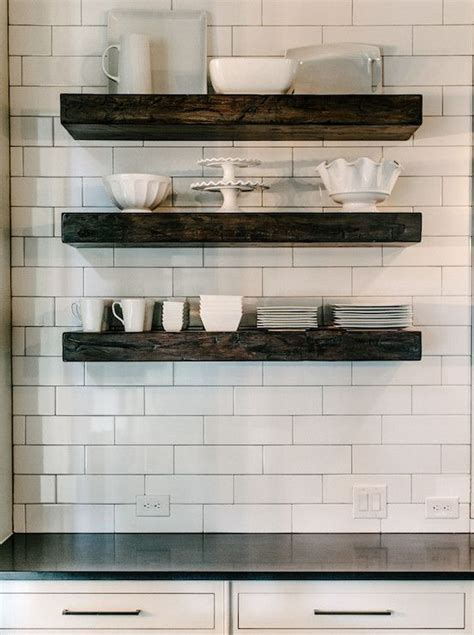 Kitchen with chunky wood floating shelves filled with