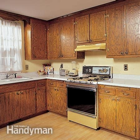 repainting old kitchen cabinets how to refinish kitchen cabinets the family handyman