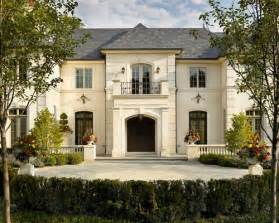 Design ideas for a large traditional beige two story stone exterior in
