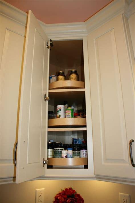 wood lazy susan in a diagonal corner wall cabinet