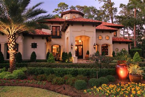 mediterranean style homes for sale an external view of the home highlighting the yard s