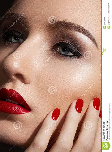 Lip Manicure fashion make up and manicure nails stock photo