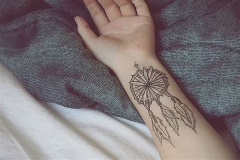 feather tattoo side of hand dreamcatcher feather hand tattoo image 662330 on