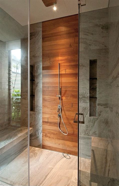 teak shower wall in combination with the mat white wall tiles and the dark floor that would