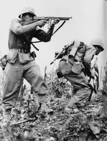Two marines davis p hargraves with thompson submachine gun and