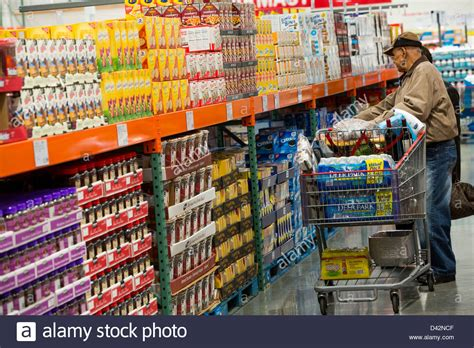 costco warehouse shopping customers shopping in the and snacks section of a costco stock photo 54150447 alamy