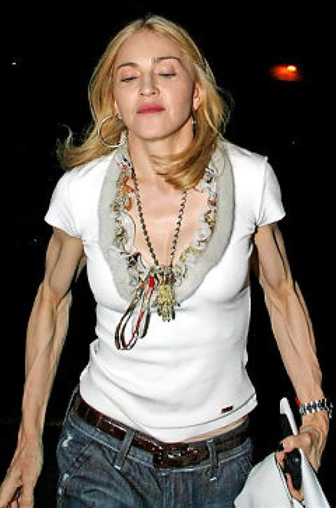 madonna arms madonna proudly shows off her stringy muscular arms in