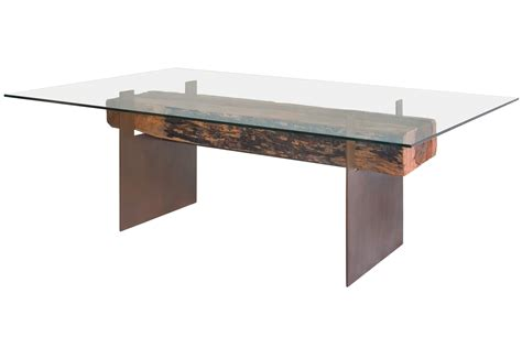 glass top dining table made with a reclaimed beam