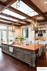 big kitchen islands this large kitchen has an island that doubles as a table and sky lights above to bring in the
