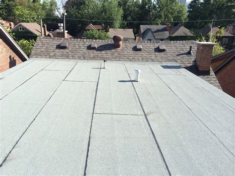 Flat Roof Installation Shingle And Flat Roofs At Yonge And Eglinton In Toronto