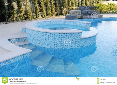 pool  blue tiles artificial waterfall  kids