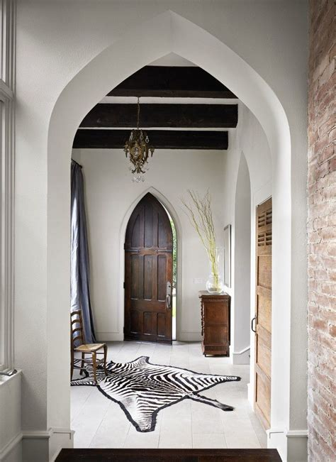 door arch design entry eclectic with wood beams white floors zebra rug
