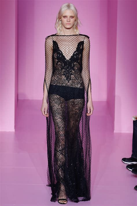 Givenchy Season 2 G8000 Nd wears a see through black lace dress at