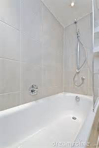 bath tub with shower attachment royalty free stock images