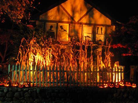 light up halloween i like the light through the corn up onto the house nice