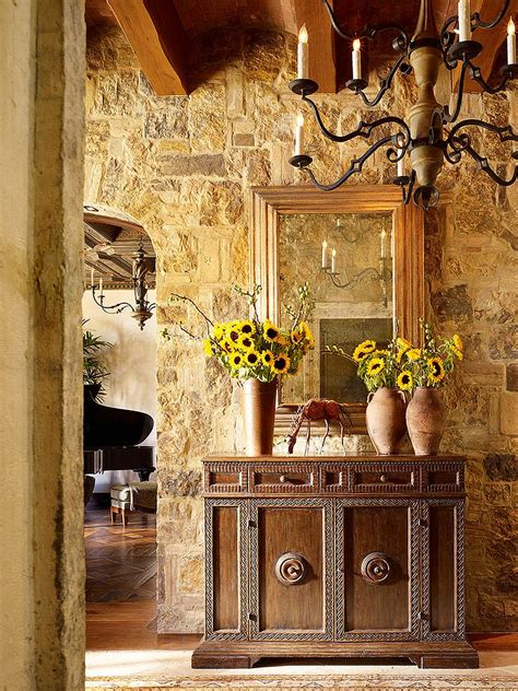 tuscan interior design stone walls and custom decor give the entry a tuscan