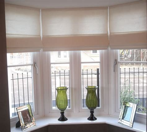 Red roman blinds on our kitchen bay window under checkered