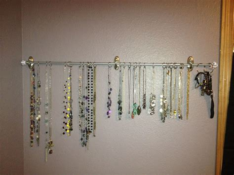 command hook curtains jewelry holder 3m command hooks holding a curtain rod 1in binder from the office supply