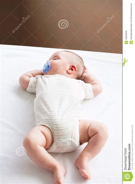 sleeping on sofa with newborn sweet baby with a pacifier sleeping on the sofa royalty