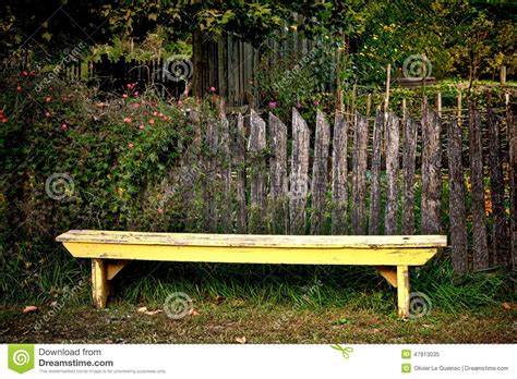 yellow garden bench antique yellow garden bench and old vintage fence stock