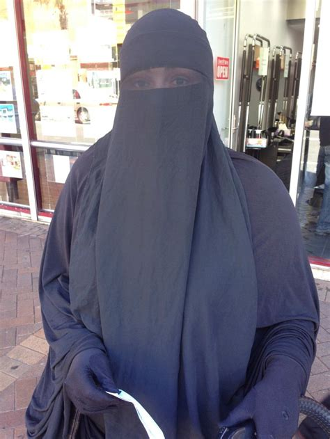 modest muslimah  double layer niqab  eyes partially