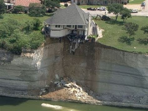 Couple Looks On As House Falls Off Cliff Youtube