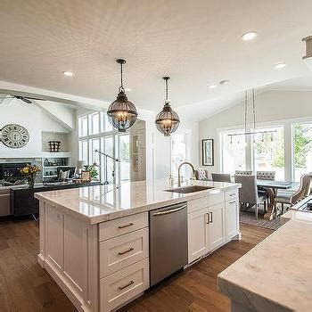 kitchen island with sink backless gray tufted counter stools with silver nailhead trim transitional kitchen