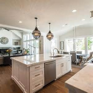 kitchen island with sink and dishwasher backless gray tufted counter stools with silver nailhead