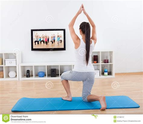 at home athletic woman doing exercises at home stock photo image