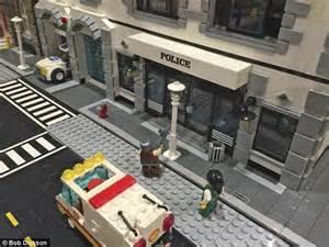design museum london lego masters ohio museum apologizes for lego gunman figure pointing at