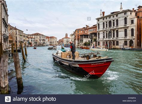 venice boat transportation transport boat on the grand canal in venice italy stock