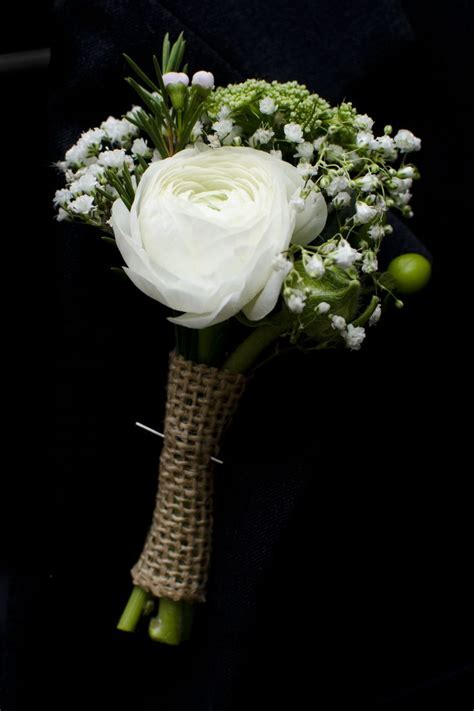 White ranunculus groom or groomsmen boutonniere with baby