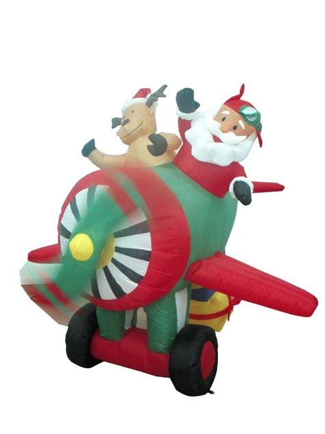 blow up santa in a boat santa airplane helicopter and balloon outdoor inflatables