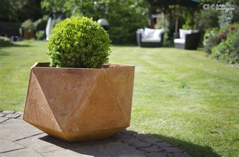 geometric corten steel planters inspired by origami symetry