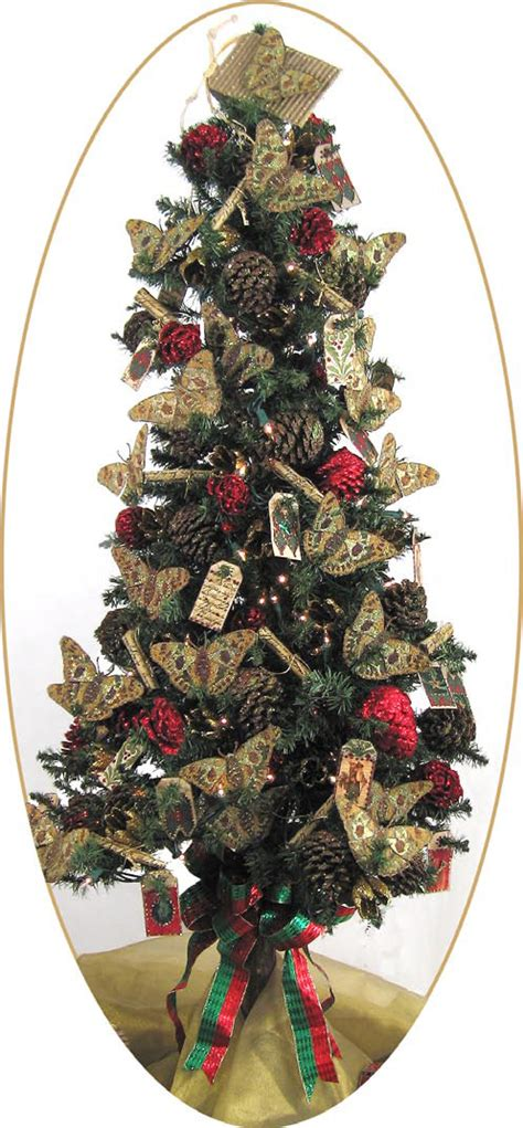 christmas tree with decorated pine cones and fabric tag