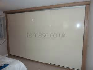 Finished product fitted wardrobe with cream high gloss sliding doors
