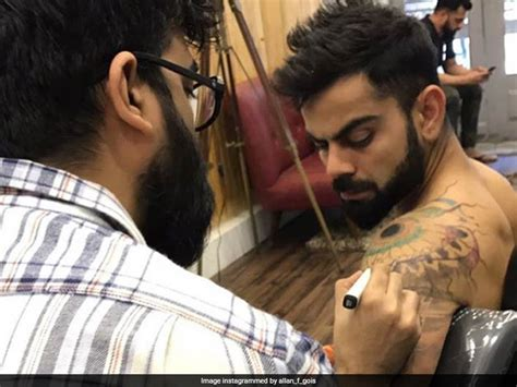 tattoo on virat kohli s arm virat kohli has a new tattoo on his left shoulder again