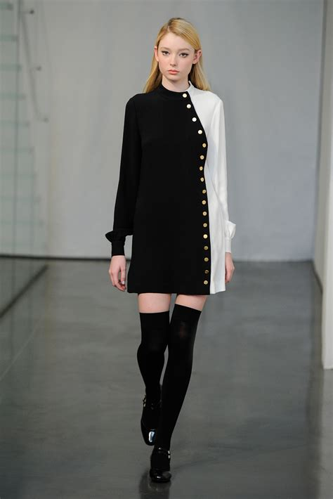 Zhoey Black High wears mini dress and thigh high boots to